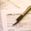 Image of tax forms with pen.