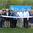 Picture of The Bank of Elk River employees and MetroNorth Chamber representatives cutting the MetroNorth Chamber of Commerce ribbon in front of The Bank of Elk River sign on Main Street in Elk River.