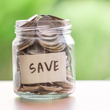 "Image of jar full of quarters with the word ""Save"" on it."
