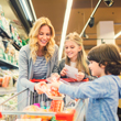 Image of mother and children grocery shopping.